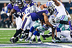 Dallas Cowboys running back Lance Dunbar (25) and Baltimore Ravens inside linebacker Daryl Smith (51) in action during the pre-season game between the Baltimore Ravens and the Dallas Cowboys at the AT & T stadium in Arlington, Texas. The Ravens lead Dallas 24 to 10 at half time.