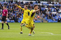 Josh Ruffels of Oxford United (right) celebrates after he scores his team's first goal of the game to make the score 1-1 during the Sky Bet League 1 match between Peterborough and Oxford United at the ABAX Stadium, London Road, Peterborough, England on 30 September 2017. Photo by David Horn.