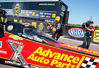 Apr 14, 2019; Baytown, TX, USA; NHRA funny car driver Robert Hight sprays Mello Yello onto the dragster of top fuel driver Brittany Force after winning the Springnationals at Houston Raceway Park. Mandatory Credit: Mark J. Rebilas-USA TODAY Sports