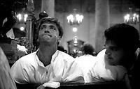 Roma  Luglio 1999.Venerabile Arciconfraternita Di Maria Ss. Del Carmine In Trastevere a Roma fondata nell' anno 1538..Lo sforzo per alzare la Statua della Madonna.<br /> http://www.arciconfraternitadelcarmine.it/