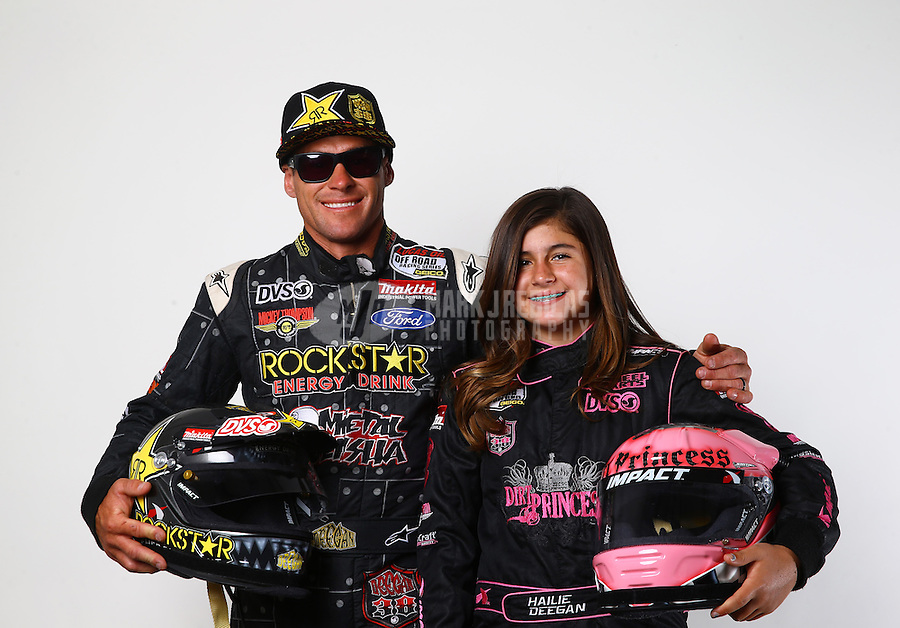 Mar. 21, 2014; Chandler, AZ, USA; LOORRS pro 2 driver Brian Deegan (left)  and daughter, junior 2 driver Hailie Deegan pose for a portrait prior to round one at Wild Horse Motorsports Park. Mandatory Credit: Mark J. Rebilas-USA TODAY Sports