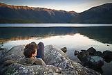 NEW ZEALAND, Nelson Lakes National Park, Woman Enjoying the View of Lake Rotoiti, Ben M Thomas