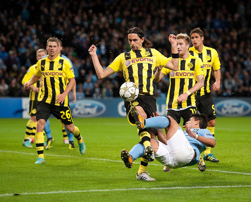 Borussia Dortmund's Neven Subotic concedes a late penalty when this shot from Manchester City's Sergio Aguero strikes his arm..Football - UEFA Champions League Group D - Manchester City v Borussia Dortmund - Wednesday 3rd October 2012 -  Etihad Stadium - Manchester..