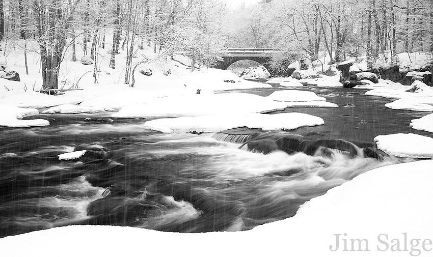 Snowfall at Packers Falls in Durham, NH.