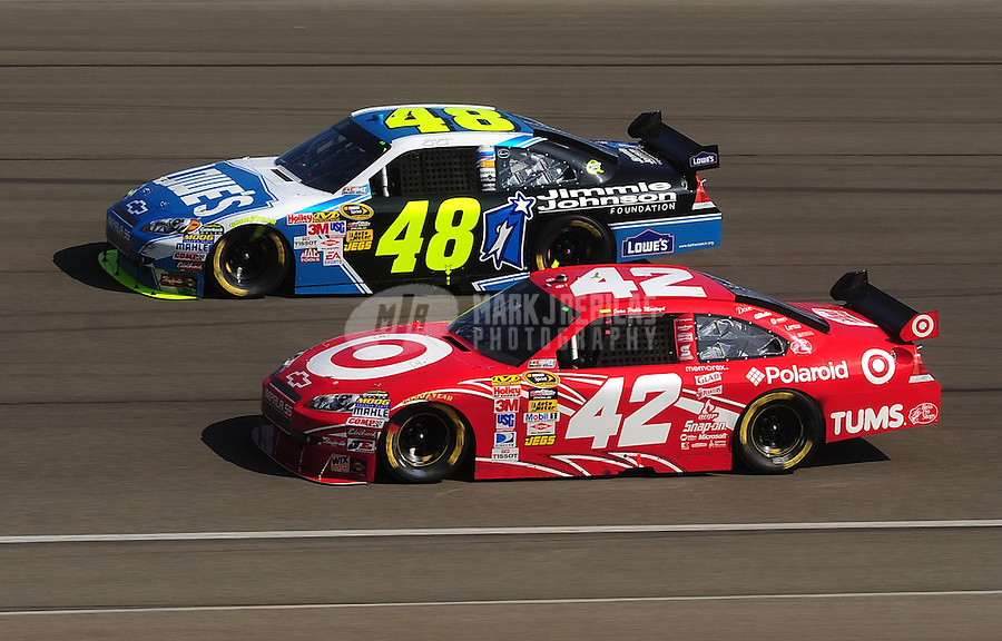 Oct. 11, 2009; Fontana, CA, USA; NASCAR Sprint Cup Series driver Jimmie Johnson (48) races alongside Juan Pablo Montoya (42) during the Pepsi 500 at Auto Club Speedway. Mandatory Credit: Mark J. Rebilas-