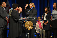 January 2, 2013  (Washington, DC)  D.C. Council member Yvette Alexander (center) takes oath of office during her swearing-in ceremony at the Washington Convention Center January 2, 2013.  (Photo by Don Baxter/Media Images International)