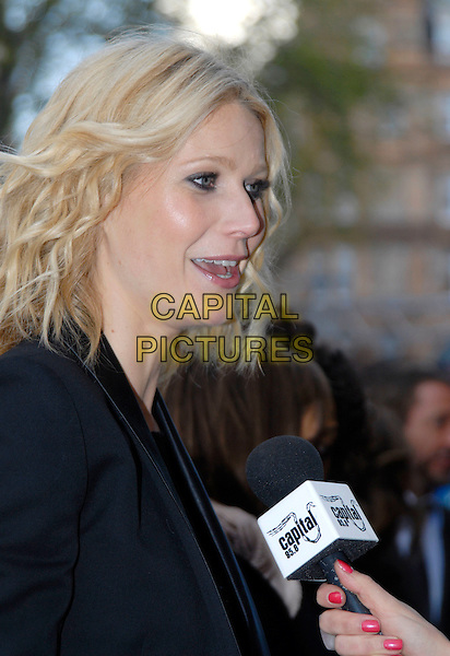 """GWYNETH PALTROW .UK Premiere of """"Iron Man"""" at the Odeon, Leicester Square, London, England, April 24th 2008..portrait headshot being interviewed microphone profile.CAP/ROS .©Steve Ross/Capital Pictures"""