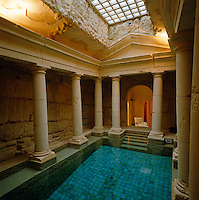 A modern indoor swimming pool has been cleverly designed to resemble a bath in an ancient Roman ruin