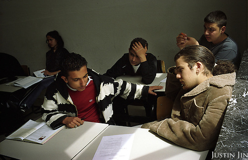 Hakan Dinc (front, in red shirt) and other Dutch-Turkish teenagers attend lesson at the De Meer pre-vocational school in Amsterdam East..The school is pre-dominantly made up of kids of Turkish and Moroccan backgrounds.  .Picture shot in Amsterdam in 2004 by Justin Jin. .