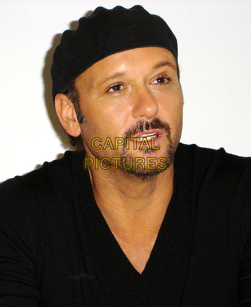 TIM McGRAW.Attending a Press Conference in Los Angeles, CA, USA, 30th October 2009..portrait headshot goatee facial hair black cap hat  v-neck                                                            .CAP/AW.©Anita Weber/Capital Pictures.