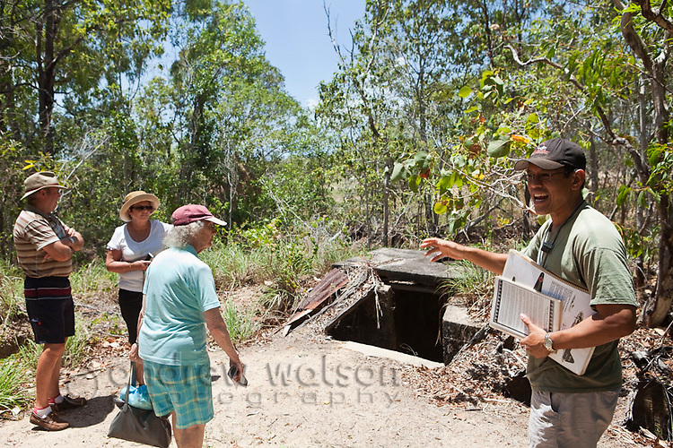 Tour group visiting World War II trenches on a heritage tour of Horn Island.  The island was a strategic outpost during WWII and was bombed numerous times by the Japanese.  Horn Island, Torres Strait Islands, Queensland, Australia