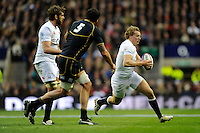 Billy Twelvetrees of England goes around Jim Hamilton of Scotland during the RBS 6 Nations match between England and Scotland at Twickenham on Saturday 02 February 2013 (Photo by Rob Munro)