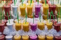Fresh fruit smoothies for sale in a farm market.