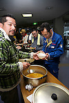 """Minamisanriku, Miyagi, Japan - The group of volunteers give food to the Japanese refugees at Sports Koryu Mura in Minamisanriku, one year after the tsunami. The Latin group of volunteers """"Todos con Japon"""" visits Miyagi area during this Golden Week."""