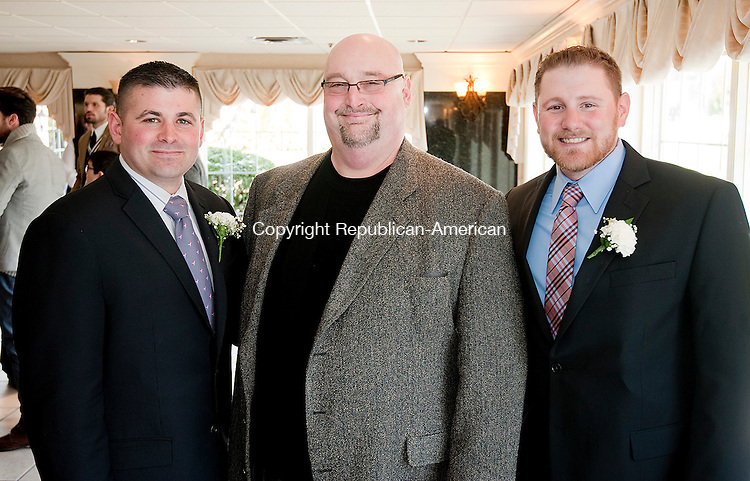 SOUTHINGTON, CT--- -040316JS06-Community Service award recipients Watertown police officers Chris Paquin, left, and Chris Donston, right, with Waterbury Sportsman Club co-treasurer Art Lanese, at the 42nd annual Waterbury Sportsmen's Club awards dinner held Sunday at the Aqua Turf in Southington. Officers Paquin and Donston organized the Watertown Police Department Charity Golf Tournament to benefit the Harold Leever Cancer Center. <br />   Jim Shannon Republican-American
