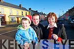 CHECKING: The Twomey family, Cian, Tim and Mag checking out the shops in Rathmore on Friday.   Copyright Kerry's Eye 2008