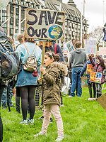London, England on 15 March 2019: a little Childe rise a protest sign during the youth climate strike in London. The protest against climate change and urge the government to take action.The global movement has been inspired by teenage activist Greta Thunberg, who has been skipping school every Friday since August to protest outside the Swedish parliament. Photo Adamo Di Loreto/BunaVista*photo
