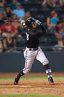 Luis Curbelo (16) of the Kannapolis Intimidators follows through on his swing against the Hickory Crawdads at L.P. Frans Stadium on July 20, 2018 in Hickory, North Carolina. The Crawdads defeated the Intimidators 4-1. (Brian Westerholt/Four Seam Images)