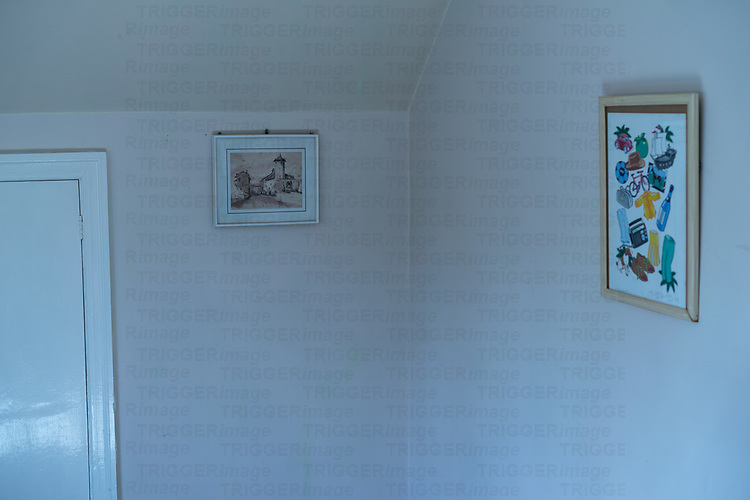 House room interior with two pictures hanging on a wall