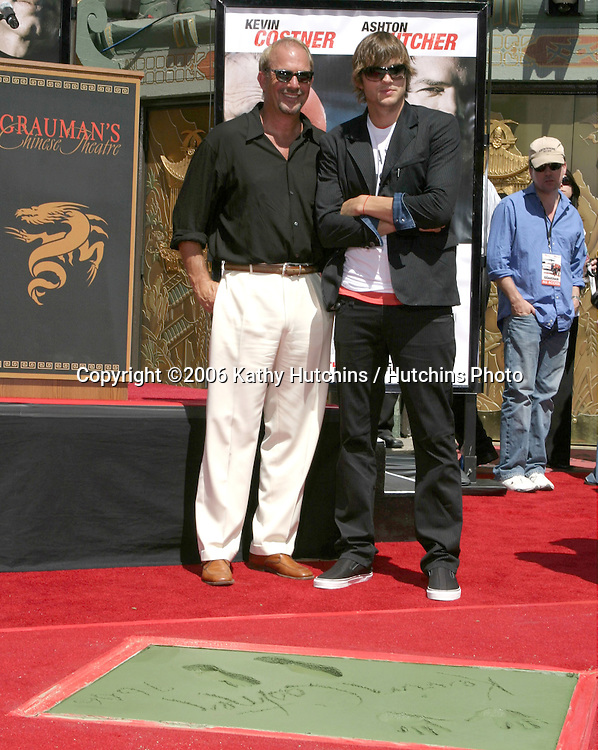 Kevin Costner & Ashton Kutcher.Kevin Costner Puts Hand & Footprints in Cement at Grauman's Chinese Theater.Los Angeles, CA.September 9, 2006.©2006 Kathy Hutchins / Hutchins Photo....