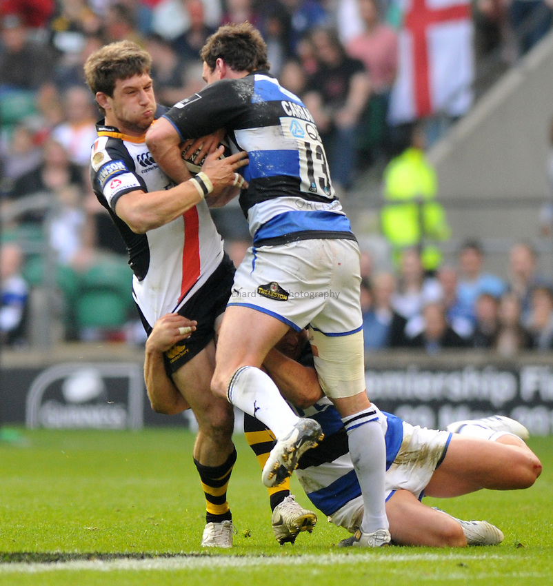 Photo: Tony Oudot/Richard Lane Photography. London Wasps v Bath Rugby. The St. George's Day Game. Guinness Premiership. 24/04/2010. .Dominic Waldouck of Wasps is challenged by Matt Carraro of Bath.