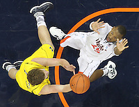 CHARLOTTESVILLE, VA- NOVEMBER 29: Akil Mitchell #25 of the Virginia Cavaliers defends Zack Novak #0 of the Michigan Wolverines during the game on November 29, 2011 at the John Paul Jones Arena in Charlottesville, Virginia. Virginia defeated Michigan 70-58. (Photo by Andrew Shurtleff/Getty Images) *** Local Caption *** Akil Mitchell;Zack Novak