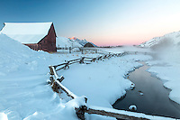 A beautiful sub-zero sunset in Jackson Hole Wyoming.  Jackson Hole's western heritage is old barns, buckrail fences and magnificent landscape.  A bit of alpenglow on the Grand Tetons Beyond.