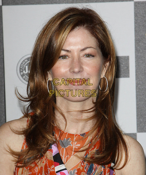 DANA DELANY .25th Annual Film Independent Spirit Awards held At The Nokia LA Live, Los Angeles, California, USA,.March 5th, 2010 ..arrivals Indie Spirit portrait headshot orange print patterned pattern dress printed  sleeveless green pink hoop earrings .CAP/ADM/KB.©Kevan Brooks/Admedia/Capital Pictures