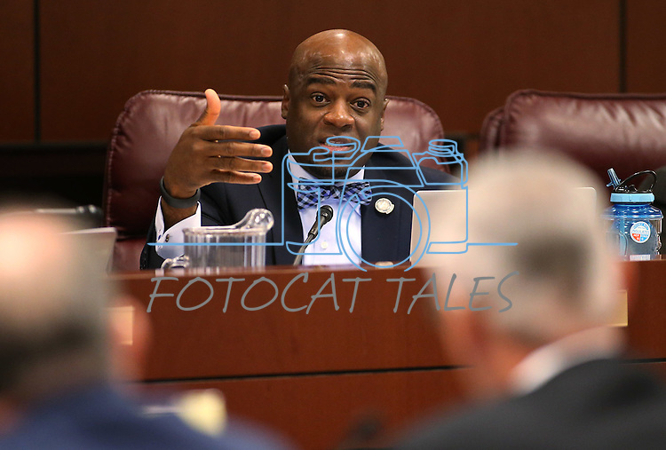 Nevada Sen. Kelvin Atkinson, D-Las Vegas, works in committee at the Legislative Building in Carson City, Nev., on Monday, Feb. 23, 2015. <br /> Photo by Cathleen Allison