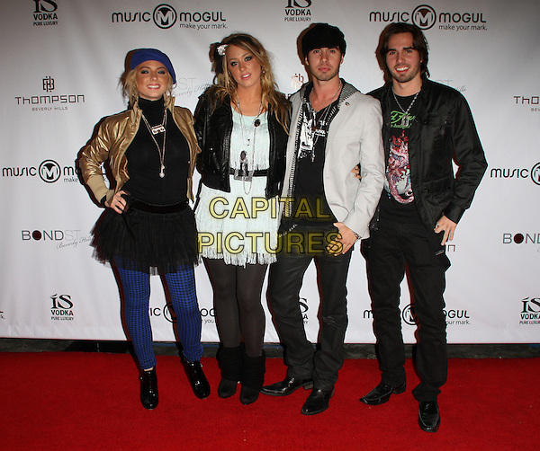 MAINSTREET .MusicMogul.com Launch Party held at The Thompson Hotel, Beverly Hills, California, USA, 24th November 2008..full length main street gold jacket hand on hip black leather white tiered dress matching tassels tights boots zips ankle  .CAP/ADM/KB.©Kevan Brooks/Admedia/Capital PIctures