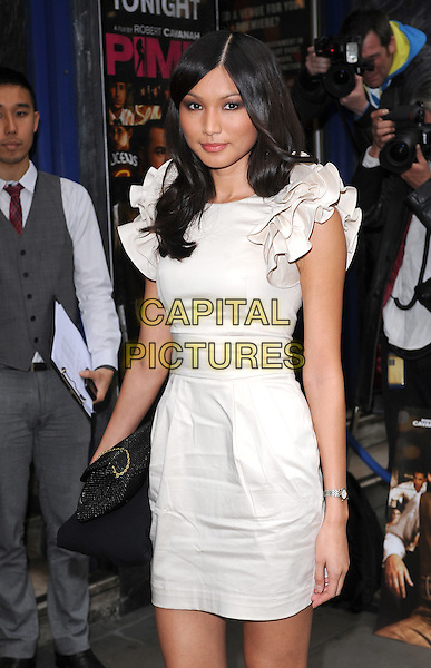 "GEMMA CHAN.The premiere of ""Pimp"", Odeon Covent Garden, London, England. .19th May 2010.full length dress cream ruffles ruffle sleeve peep toe shoes beige.CAP/BEL.©Tom Belcher/Capital Pictures."