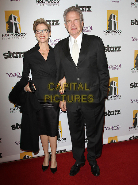 ANNETTE BENING & WARREN BEATTY.14th Annual Hollywood Awards Gala Presented By Starz held at The Beverly Hilton Hotel, Beverly Hills, CA, USA. .October 25th, 2010 .full length black glasses leather skirt top suit white shirt married husband wife.CAP/ADM/KB.©Kevan Brooks/AdMedia/Capital Pictures.