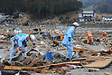 1:49 PM, March 16, 2011, Rikuzentakada, Iwate Prefecture, Japan - Firemen and other rescue workers seach the debris covering Rikuzentakada, Iwate Prefecture, after the Tohoku-Kanto Natural Disaster. (Photo by Mainichi Newspaper)