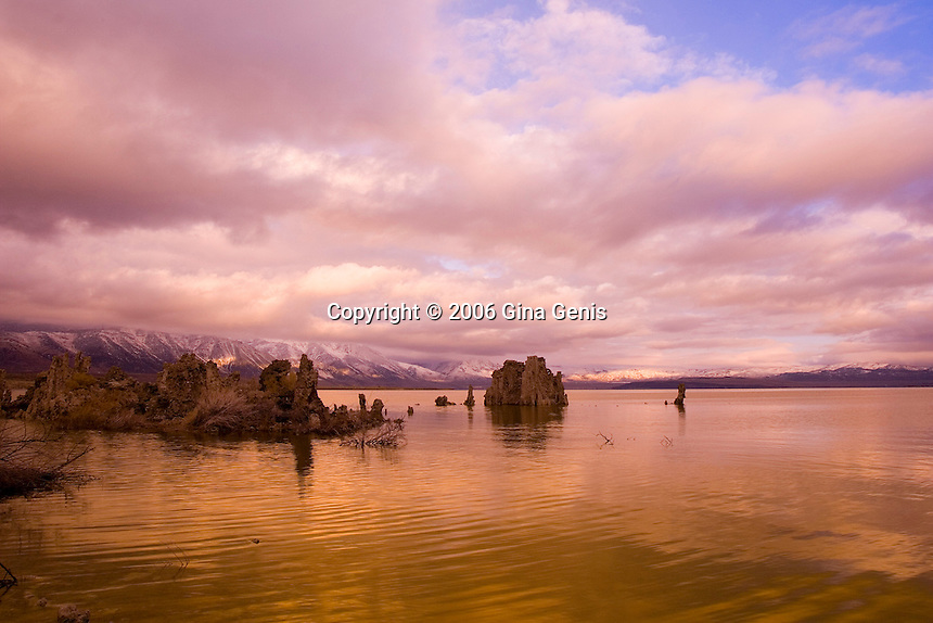 Mono Lake under a stormy sky with snowy Eastern Sierra mountains in the background