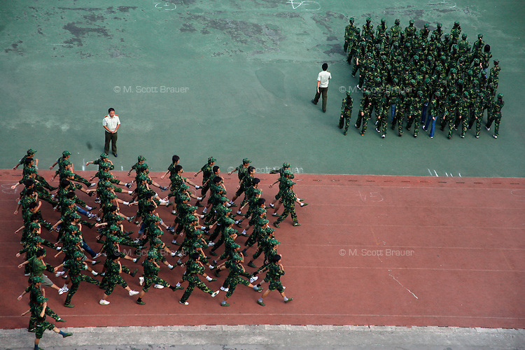 Freshmen at the Nanjing University of Traditional Chinese Medicine line up for military training on a basketball court in Nanjing, China. After the 1989 Tiananmen Square protests, the Chinese government has required military training for all university and college students in the country.