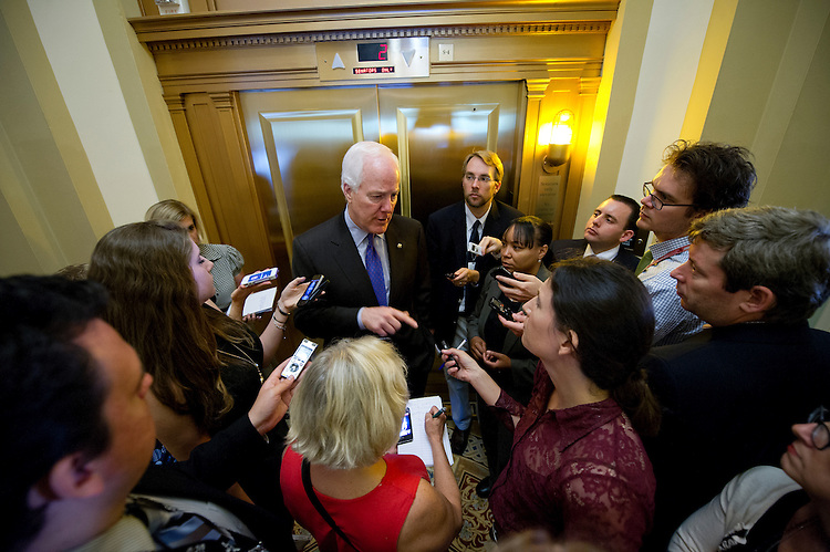 UNITED STATES - June 25: Sen. John Cornyn, R-Texas, speaks to reporters in the Ohio Clock Corridor following the Senate Republicans' lunch in the U.S. Capitol on June 25, 2013 for the Senate luncheons.  (Photo By Douglas Graham/CQ Roll Call)