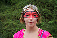 Beautiful girl wearing face painted red mask, Northwest Folklife Festival 2016, Seattle Center, Washington, USA.