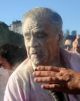 A mob attacks 71 year-old TV reporter Julio Bazan   near the Congress building while Deputies Chamber was   discussing changes in   retirement legislation