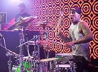 LAS VEGAS, NV - December 31 : Travis Barker and Yelawolf peform at RAIN Nightclub at Palms Resort in Las Vegas, Nevada on December 31, 2012.  Credit: Kabik/Starlitepics/MediaPunch Inc.
