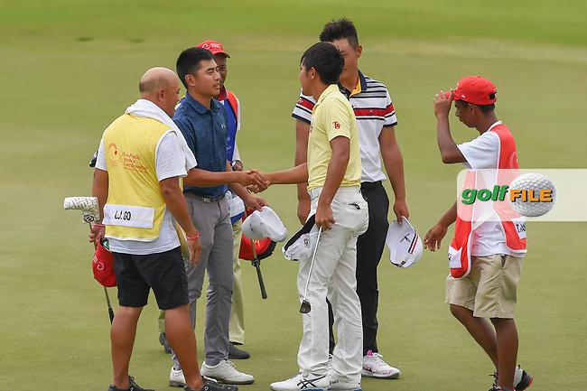 Lloyd Jefferson GO (PHI) congratulates Takumi KANAYA (JPN) for winning the Asia-Pacific Amateur Championship, Sentosa Golf Club, Singapore. 10/7/2018.<br /> Picture: Golffile | Ken Murray<br /> <br /> <br /> All photo usage must carry mandatory copyright credit (© Golffile | Ken Murray)
