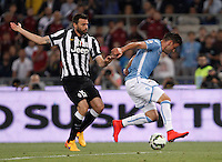 Calcio, finale Tim Cup: Juventus vs Lazio. Roma, stadio Olimpico, 20 maggio 2015.<br /> Lazio's Filip Djordjevic, right, is challenged by Juventus' Andrea Barzagli during the Italian Cup final football match between Juventus and Lazio at Rome's Olympic stadium, 20 May 2015.<br /> UPDATE IMAGES PRESS/Isabella Bonotto