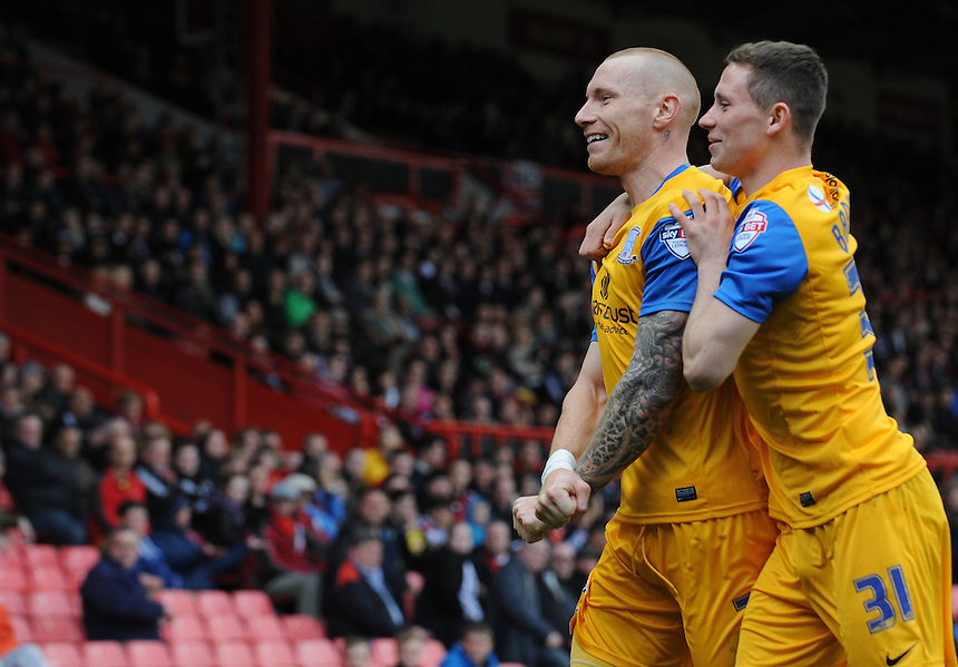 Preston North End's Jack King celebrates scoring his sides first goal with team-mate Alan Browne<br /> <br /> Photo by Ian Cook/CameraSport<br /> <br /> Football - The Football League Sky Bet League One - Bristol City v Preston North End - Saturday 5th April 2014 - Ashton Gate - Bristol<br /> <br /> &copy; CameraSport - 43 Linden Ave. Countesthorpe. Leicester. England. LE8 5PG - Tel: +44 (0) 116 277 4147 - admin@camerasport.com - www.camerasport.com