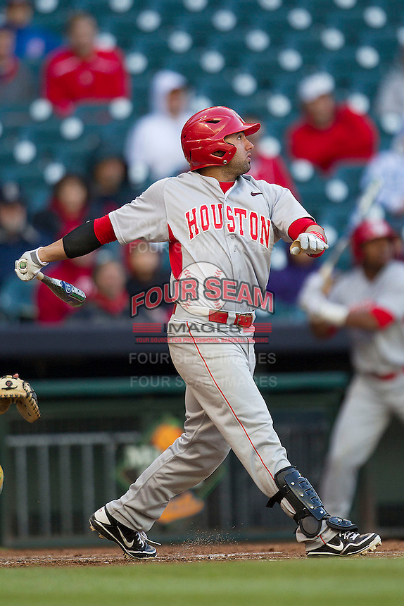 Houston Cougars shortstop Frankie Ratcliff #7 follows through on his swing against the Baylor Bears in the NCAA baseball game on March 2, 2013 at Minute Maid Park in Houston, Texas. Houston defeated Baylor 15-4. (Andrew Woolley/Four Seam Images).