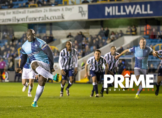 Adebayo Akinfenwa of Wycombe Wanderers scores from the penalty spot during the Checkatrade Trophy round two Southern Section match between Millwall and Wycombe Wanderers at The Den, London, England on the 7th December 2016. Photo by Liam McAvoy.