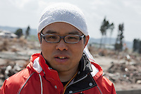 Clean up Volunteer, Yoshi Nakayama from Shimane, in the flattened landscape caused by the tsunami of March 11th on Kitahara and Kaibama, Haramachi ku, Soma, Fukashima, Japan. Wednesday May 4th 2011