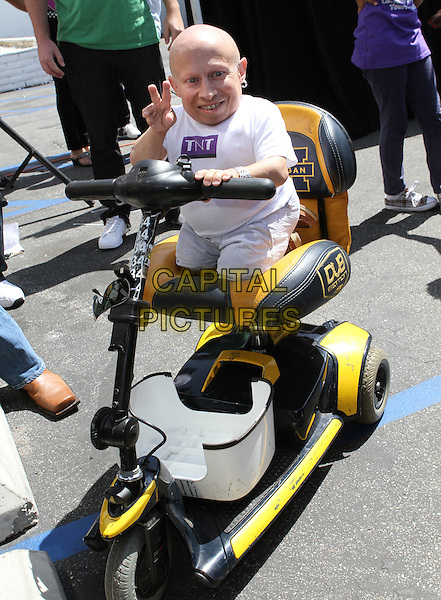 VERNE TROYER .Celebrity Go Kart Tournament  Held At K1 Speed Indoor Go-Kart Racing,  Gardena, California, USA, .28th May 2011..full length white t-shirt on scooter electric sitting v hand fingers gesture sign .CAP/ADM/KB.©Kevan Brooks/AdMedia/Capital Pictures.