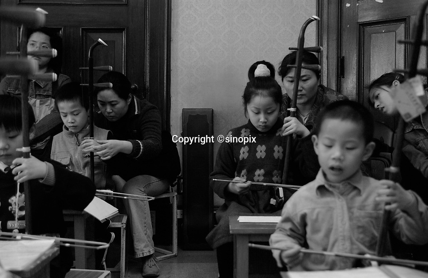 "Children undergo special extra schooling at a ""Children's Palace ion Shanghai, China. The Palaces offer extra tuition to doting parents who are only able to have a single Child under the strict One Child Policy law.  The single child each of whom has the attention of parents and 4 grandparents are often referred to as ""Little Emperors"""