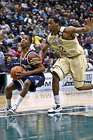 February 03, 2011:    Belmont Bruins guard Kerron Johnson (3) drives around Jacksonville Dolphins forward Shamile Jeffers (12) during Atlantic Sun Conference action between the Jacksonville Dolphins and the Belmont Bruins at Veterans Memorial Arena in Jacksonville, Florida.  Belmont defeated Jacksonville 76-70.