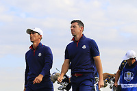 Thorbjorn Olesen and Rory McIlroy Team Europe walk off the 9th tee during Friday's Fourball Matches at the 2018 Ryder Cup, Le Golf National, Iles-de-France, France. 28/09/2018.<br /> Picture Eoin Clarke / Golffile.ie<br /> <br /> All photo usage must carry mandatory copyright credit (© Golffile | Eoin Clarke)