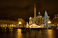 St Peter in Rome at night with christmas decoration and the nativity scene